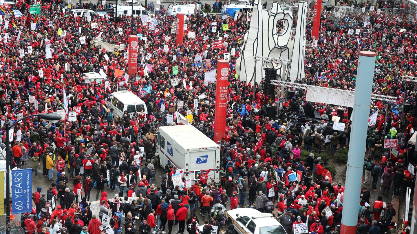 Chicago Teachers Union members and supporters attend a rally at the Thompson Center before marching during a one-day strike by teachers April 1, 2016, in Chicago.