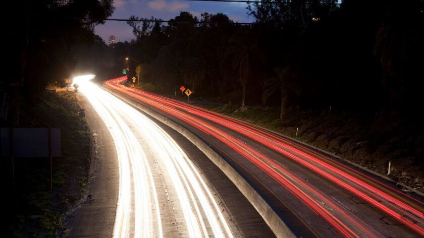 Headlights from north bound traffic and taillights from southbound on SR-163 as viewed from the Robinson Street bridge.