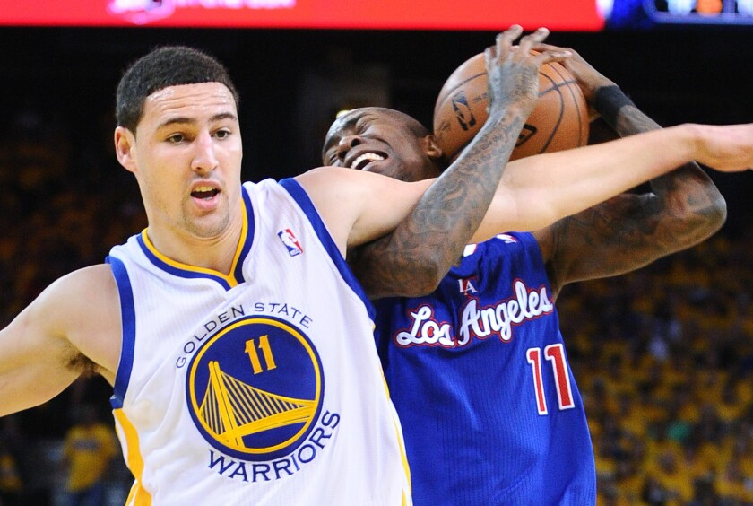Clippers Jamal Crawford is fouled by Warriors forward Klay Thompson during a 2014 NBA playoff game.