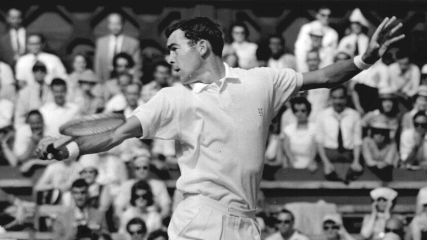 Mike Davies in action against G Mulloy at Wimbledon Tennis Championship in 1960.