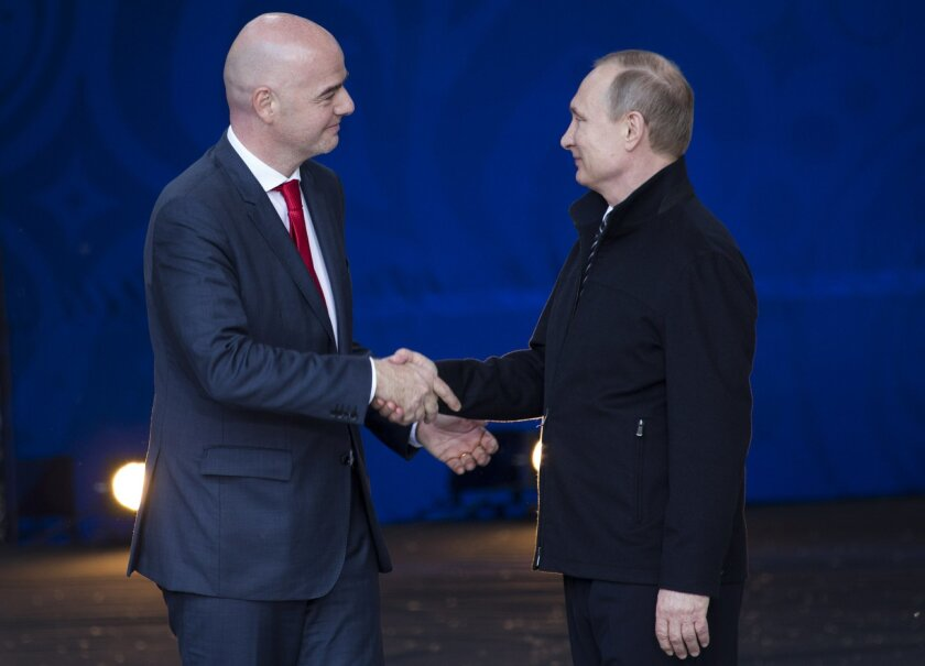 Russian President Vladimir Putin, right, and FIFA President Gianni Infantino shake hands at the opening ceremony of World Cup Volunteers Programme ahead of the 2018 football tournament in Moscow, Russia, Wednesday, June 1, 2016. Russian President Vladimir Putin and FIFA President Gianni Infantino a