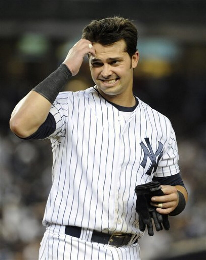New York Yankees' Nick Swisher scratches his head after striking out off Baltimore Orioles relief pitcher Darren O'Day in the eighth inning of a baseball game on Friday, Aug., 31, 2012, at Yankee Stadium in New York. (AP Photo/Kathy Kmonicek)