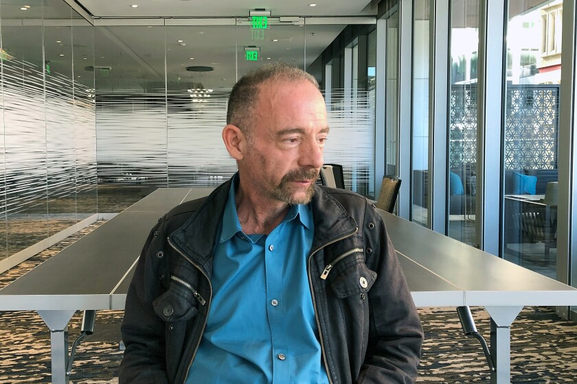 FILE - In this Monday, March 4, 2019 file photo, Timothy Ray Brown poses for a portrait in Seattle. Brown, an American who was known for years as the Berlin patient, had a transplant in Germany from a donor with natural resistance to the AIDS virus. It was thought to have cured Brown's leukemia and HIV. But in an interview Thursday, Sept. 24, 2020, Brown said his cancer returned last year and has spread widely. His case has inspired scientists to seek more practical ways to try to cure the disease. (AP Photo/Manuel Valdes)