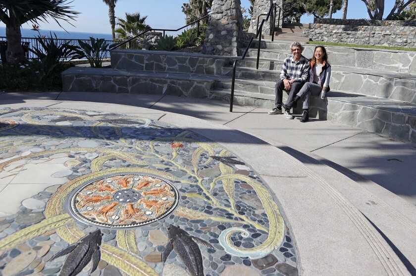 "Artists Scott and Naomi Schoenherr at the site of their new public art creation, ""Lunar Tides"" in Heisler Park."