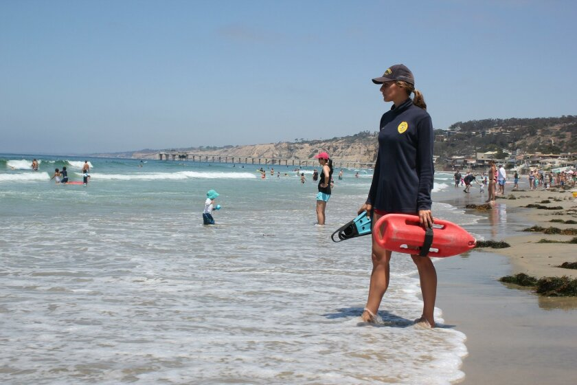 """""""(Lifeguards) are a pretty small agency, considering we have 94 permanents and 200 seasonals. It can get a little like high school sometimes with the gossip that goes around and the telephone, but it's great,"""" Dana Nelsen said."""