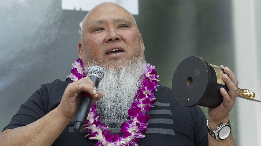 HUNTINGTON BEACH, CA, July 29, 2016 -- Spiritual leader and surfer Sumo Sato talks during an inducti