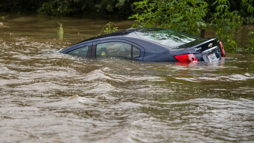 A vehicle is submerged in floodwaters in Youngsville, La., Aug. 14.