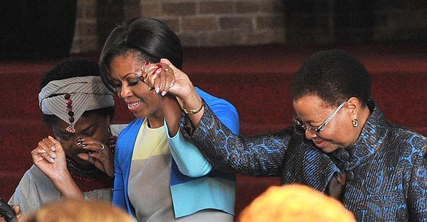 First Lady Michelle Obama arrives with Nelson Mandela's wife, Graca Machel, in Soweto, South Africa. Speaking at Regina Mundi church, once a haven for activists fighting white-minority rule, Obama invoked the memory of leaders of the American civil-rights movement and South Africa's liberation struggle to encourage young leaders.