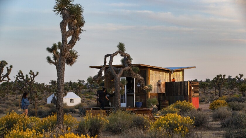 JOSHUA TREE, CA - MAY 15, 2018: Lazy Sky Retreat has outdoor showers, a communal kitchen and tip