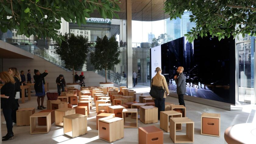 The lower floor of the new Apple store that has a large and state of the art screen for teaching. A