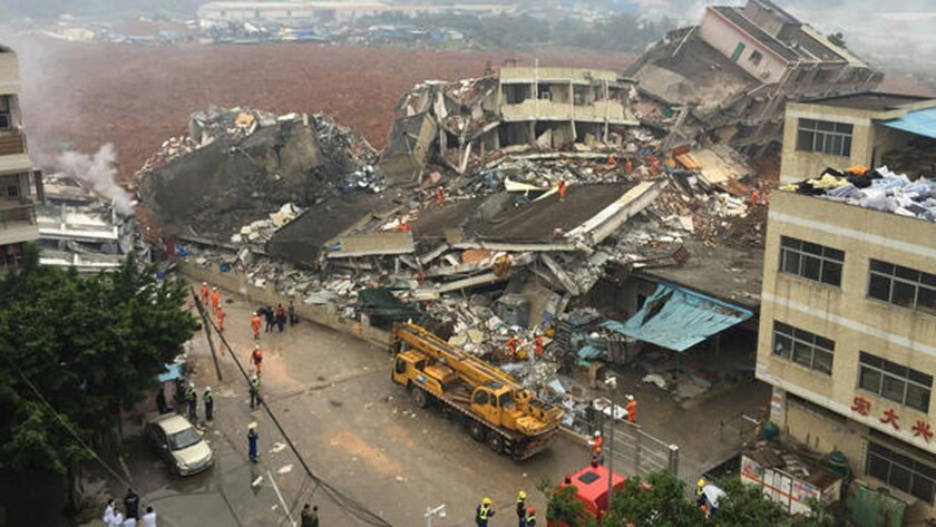Rescuers work at the scene of collapsed factory buildings after a landslide in Shenzhen, China.