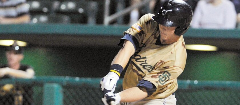 Tucson Padres star Anthony Rizzo, taking a swing against the Salt Lake Bees at Kino Stadium in Tucson, is expected to make his San Diego Padres debut on Thursday.