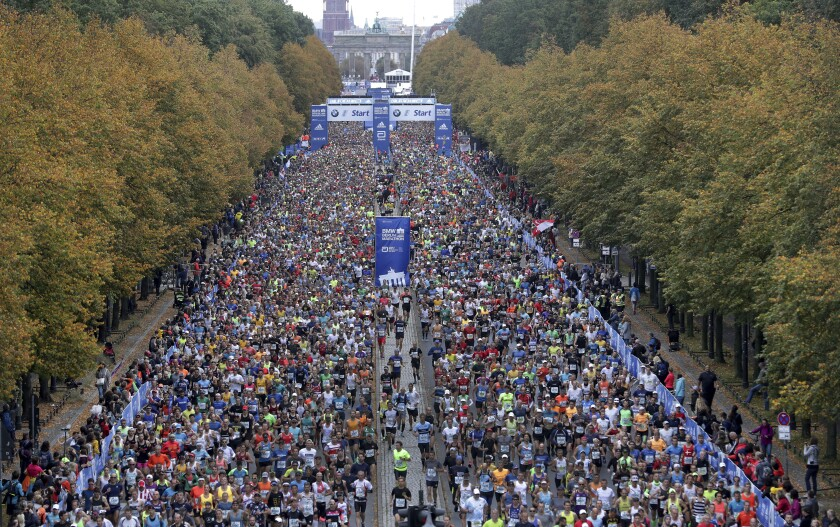 FILE - In this Sept.29, 2021 file photo runners start for the 46th Berlin Marathon in Berlin, Germany. Berlin Marathon returns after break with 25,000 participants on Sunday. (AP Photo/Michael Sohn, file)