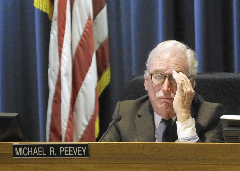 Michael Peevey, former president of the California Public Utilities Commission, listens to comment during a meeting of the five-member commission in San Francisco in 2014.