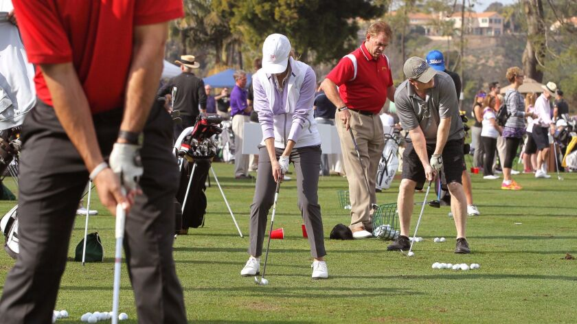 Golfers try for a hole in one at the Operation Game On 15 inch Hole-In-One Challenge at the Fairbanks Ranch Country Club.