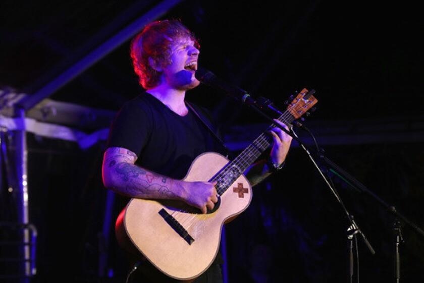 Ed Sheeran performs at Rock for EB.
