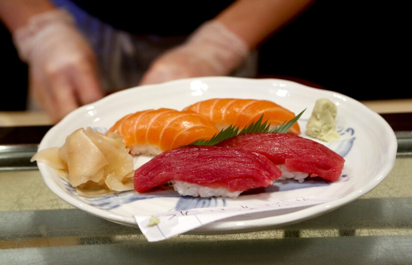 Gloves are worn to prepare sushi at Sushi Gen after a food safety law went into effect in California in January.