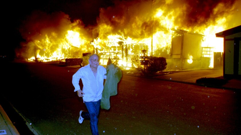 Sylmar resident Brian Demetz runs from his burning home in Sylmar on Jan. 17, 1994, after the Northridge earthquake.