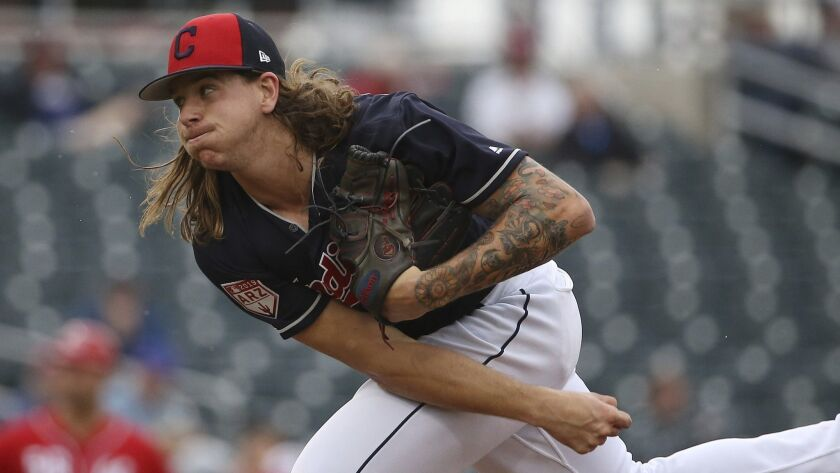 Cleveland Indians pitcher Mike Clevinger throws a pitch during the fourth inning of a spring trainin