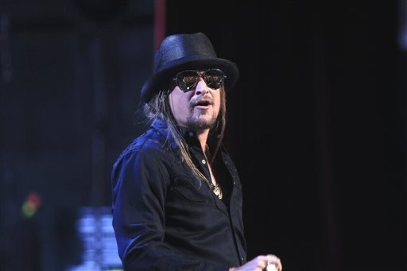 In this May 12, 2012 photo, Kid Rock performs with the Detroit Symphony Orchestra at the Fox Theatre in Detroit. Brian D. Keith, who authorities say tried to break into musician Kid Rock's suburban Detroit home, pleaded no contest to charges to attempted home invasion, malicious destruction of a building and malicious destruction of personal property in Oakland County Circuit Court, Wednesday, Sept. 4, 2013. (AP Photo/Carlos Osorio)