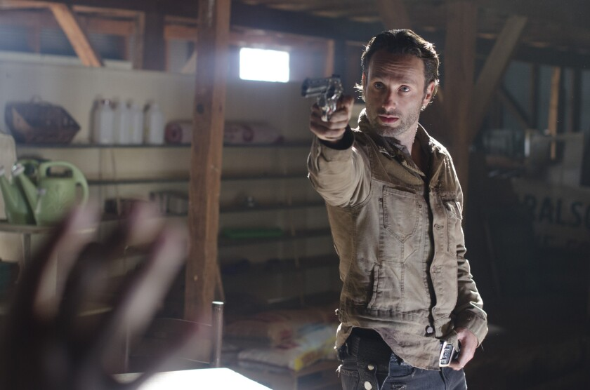"""Andrew Lincoln appears in a scene from """"The Walking Dead."""" The show has been using second-screen technology to engage viewers."""