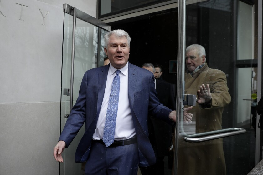 """FILE - Johnny """"Doc"""" Dougherty departs the federal courthouse in Philadelphia, in this Friday, Feb. 1, 2019, file photo. Philadelphia labor leader Johnny """"Doc"""" Dougherty goes on trial Monday, Oct. 4, 2021, in a City Hall corruption case that accuses him of keeping Councilman Bobby Henon on the union payroll to push his agenda. Dougherty, a powerful figure in Pennsylvania politics, faces a second trial over union activities.(AP Photo/Matt Slocum, File)"""