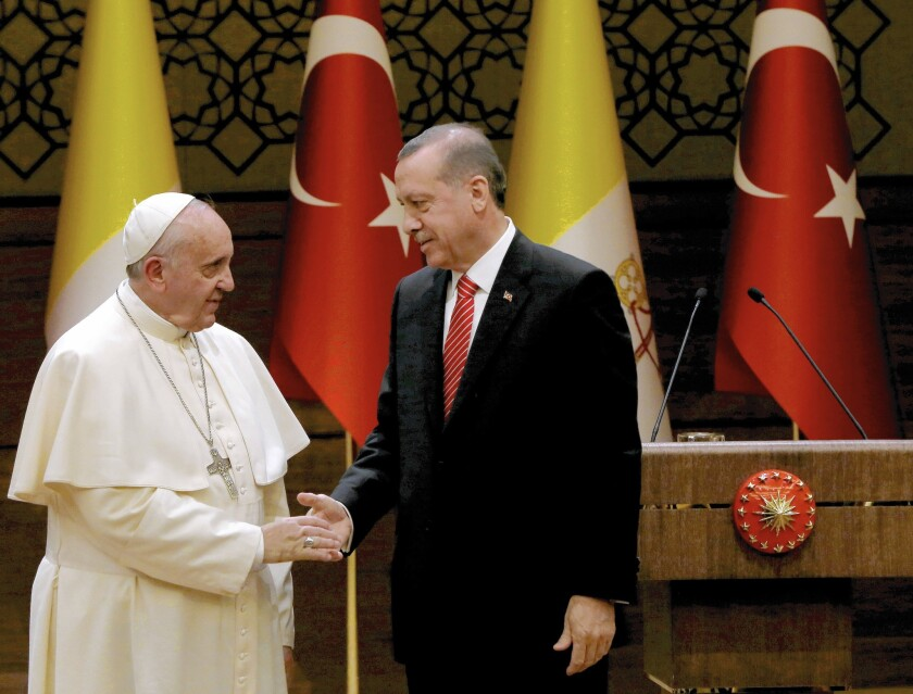 Pope Francis is greeted by Recep Tayyip Erdogan in Ankara.