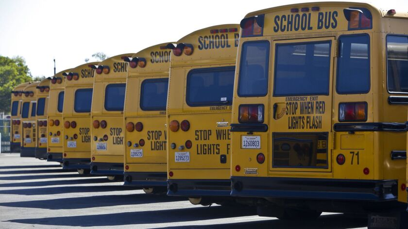 The Oceanside Unified School District buses. The district is at risk of fiscal insolvency, according to a state report.