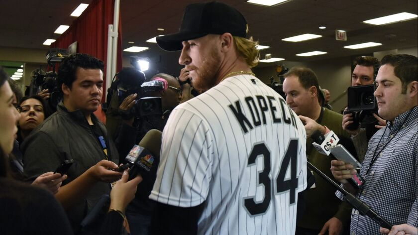Chicago White Sox's Michael Kopech talks to reporters during the baseball team's convention Friday,