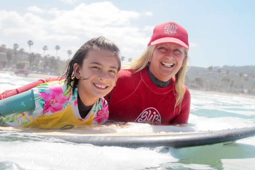 The author and her daughter, Annabelle, paddle out.