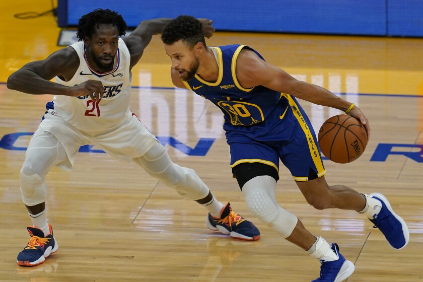Golden State Warriors guard Stephen Curry, right, drives against Los Angeles Clippers guard Patrick Beverley during the first half of an NBA basketball game in San Francisco, Wednesday, Jan. 6, 2021. (AP Photo/Jeff Chiu)