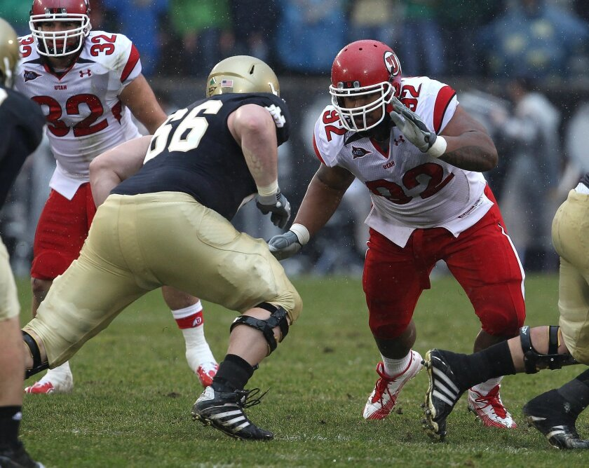 Star Lotulelei #92 of the Utah Utes rushes against Chris Watt #66 of the Notre Dame Fighting Irish at Notre Dame Stadium on November 13, 2010 in South Bend, Indiana.