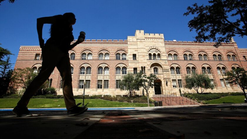 LOS ANGELES, CA-JUNE 20, 2013: A pedestrian walks near the Humanties Building on the UCLA campus in