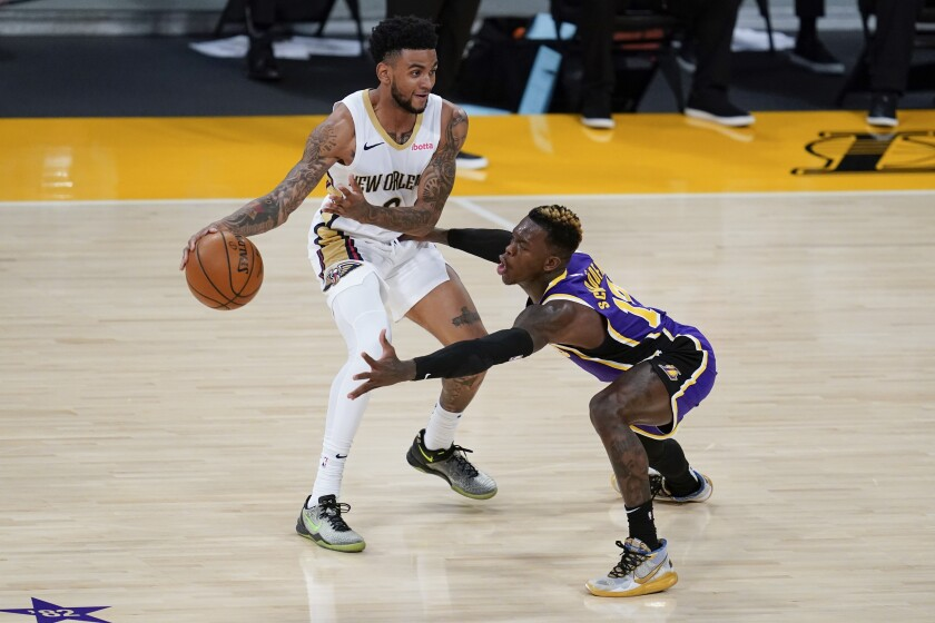 Los Angeles Lakers guard Dennis Schroeder, right, defends against New Orleans Pelicans guard Nickeil Alexander-Walker during the second quarter of an NBA basketball game Friday, Jan. 15, 2021, in Los Angeles. (AP Photo/Ashley Landis)