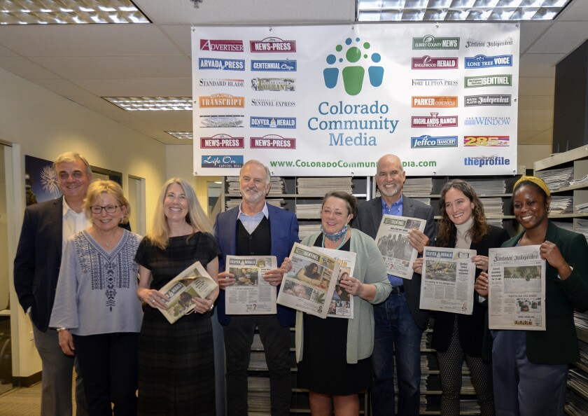From left, Colorado Community Media owners Jerry and Ann Healey join Fraser Nelson and Marc Hand from the National Trust for Local News, Dana Coffield and Larry Ryckman of the Colorado Sun, and Elizabeth Hansen Shapiro and Lillian Ruiz, also from the National Trust for Local News, in a photograph after the announcement that the Healeys have sold their 24 suburban Denver newspapers to the Colorado News Conservancy, Monday, May 3, 2021, in Englewood, Colo. (John Leyba/The Colorado Sun via AP)