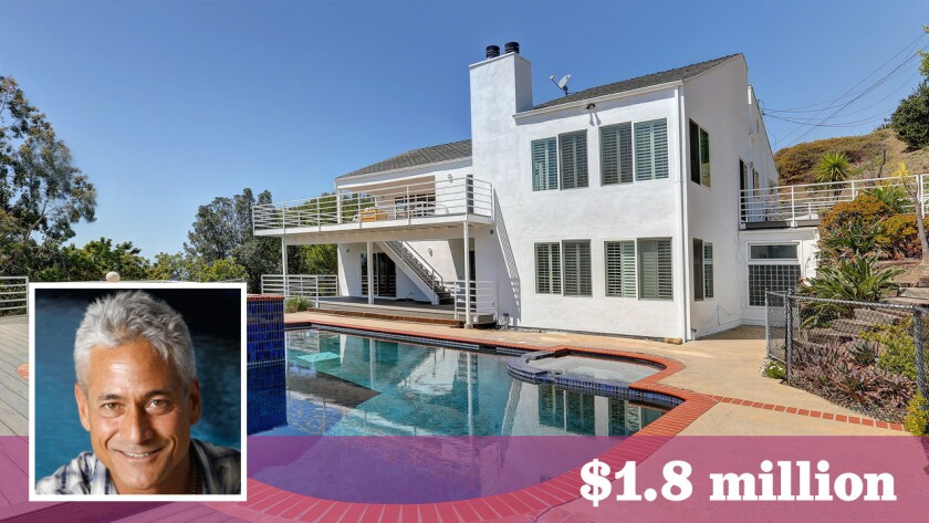 Greg Louganis has sold his ocean-view home in Malibu for $1.8 million.