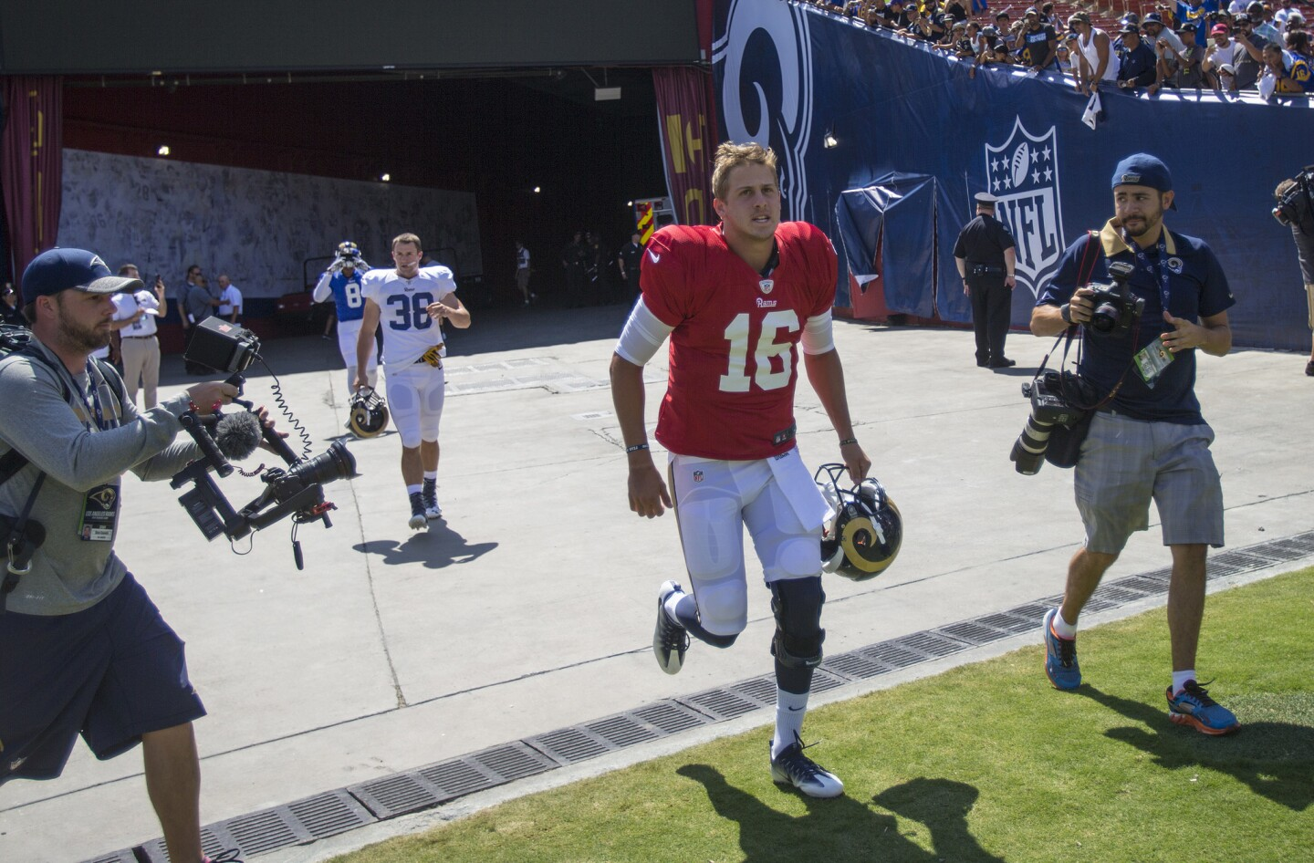 LOS ANGELES, CA - AUGUST 6, 2016: Rams rookie quarterback Jared Goff (#16) enters the L.A. Coliseum of the first time as a Ram before a team scrimmage on August 6, 2016 in Los Angeles, California.(Gina Ferazzi / Los Angeles Times)