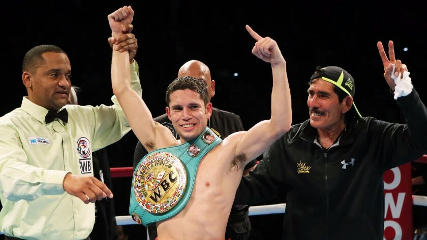 Carlos Cuadras celebrates after retaining his WBC super-flyweight title in Japan in 2015. He lost the belt the next year.