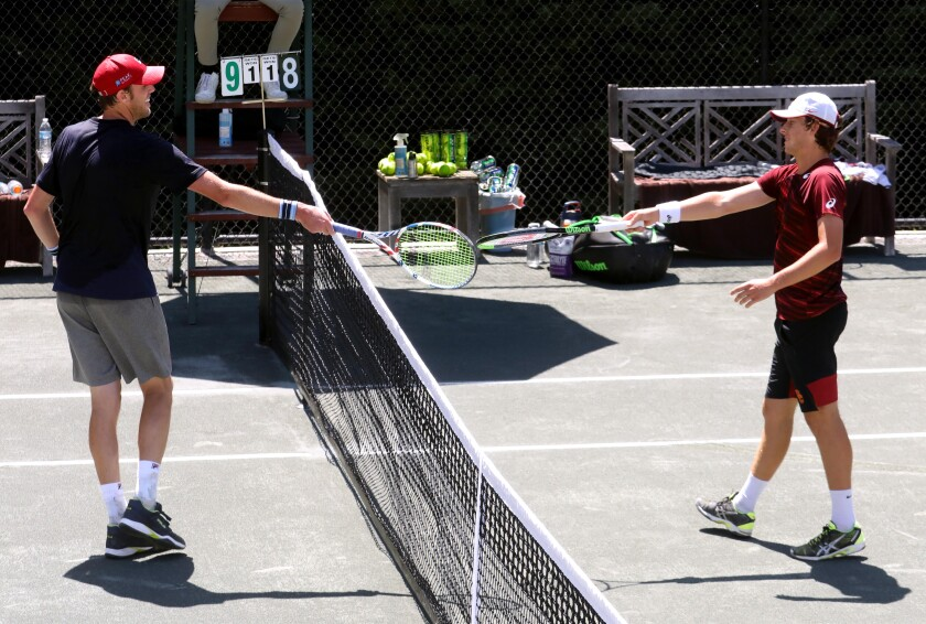 Sam Querrey, left, and Brandon Holt touch rackets instead of shaking hands.