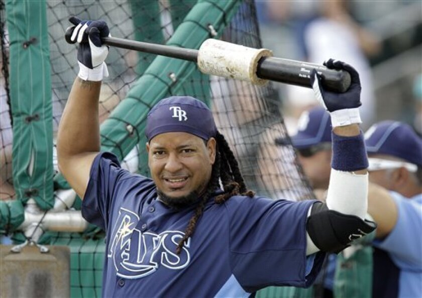 FILE - In this March 16, 2011, file photo, Tampa Bay Rays' Manny Ramirez warms up before a spring training baseball game against the Florida Marlins in Jupiter, Fla. The Oakland Athletics still have strong interest in signing Ramirez, who presents a low-risk investment for the rebuilding franchise.