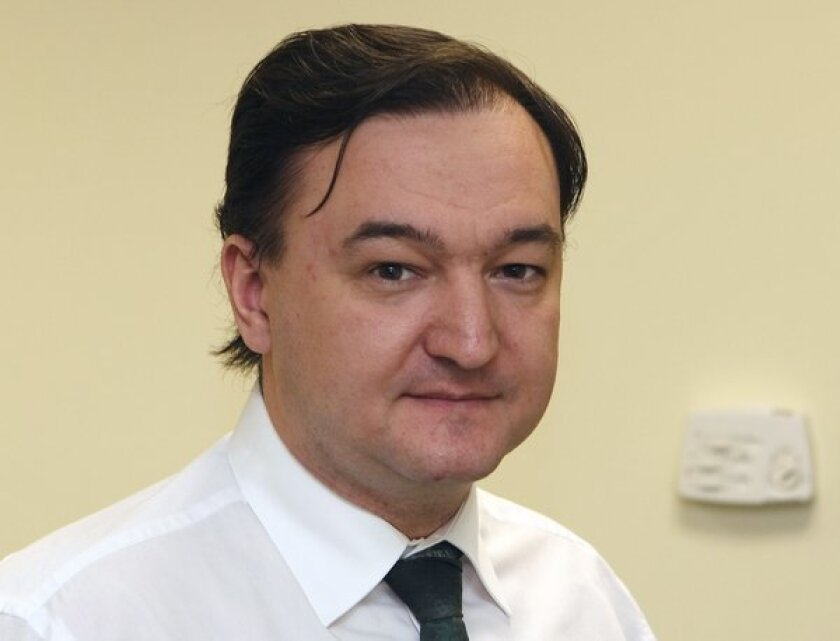 Russian court convicts dead lawyer Magnitsky; case led to adoption ban