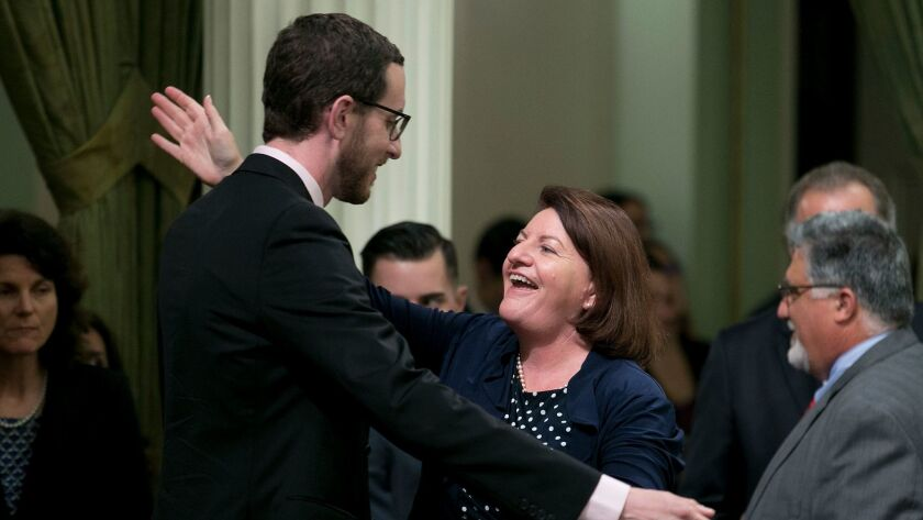 State Sen. Toni Atkins (D-San Diego) receives congratulations from Sen. Scott Wiener (D-San Francisco) after her housing measure was approved by the state Assembly on Thursday.