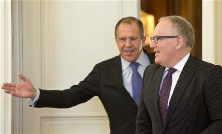 Russian Foreign Minister Sergey Lavrov, left, welcomes his Dutch counterpart Frans Timmermans for a meeting in Moscow, Russia, Tuesday, Feb. 26, 2013. (AP Photo/Misha Japaridze)