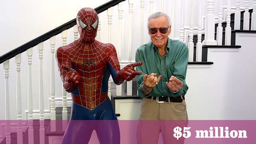 Stan Lee poses next to a statue of Spider-Man in a listing photo for his Bird Streets home.