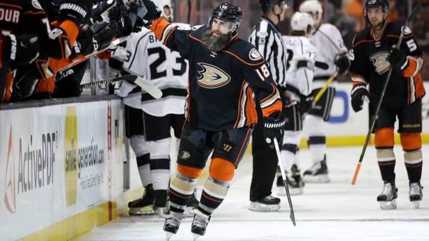 Anaheim Ducks' Patrick Eaves, center, celebrates his goal with teammates during the first period of