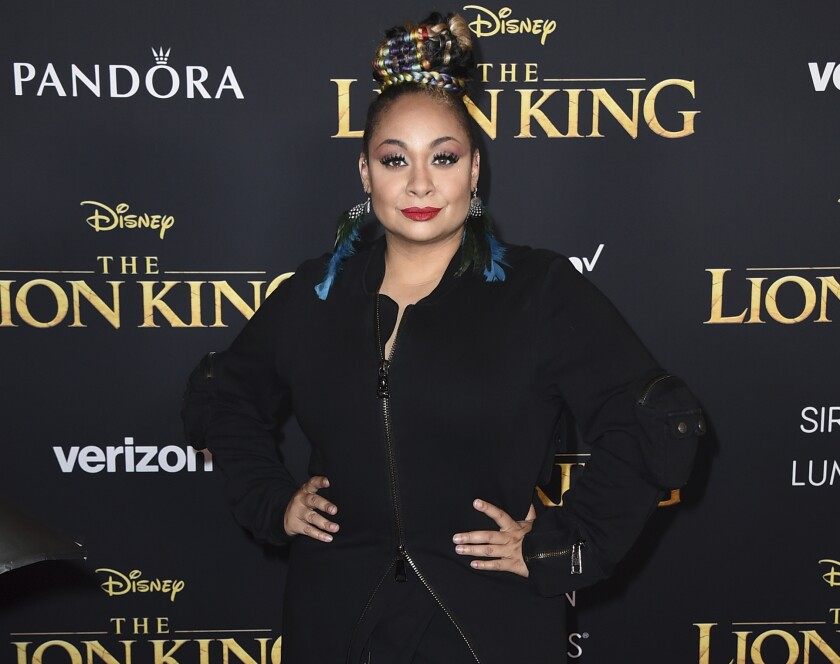 """FILE - In this July 9, 2019 file photo, Raven-Symone arrives at the world premiere of """"The Lion King"""" in Los Angeles. The actor said online she was married this week to Miranda Maday, posting photos that showed the couple embracing. In another post, she offered thanks to those who helped with the wedding and to """"those who understand why it was small during this time,"""" an apparent reference to the pandemic that has limited large gatherings. (Photo by Jordan Strauss/Invision/AP, FIle)"""
