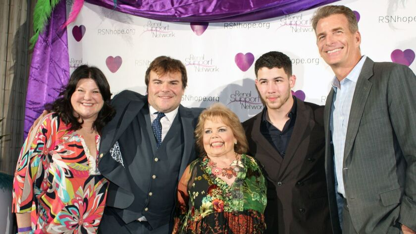 Posing for photographers at the Renal Teen Prom are from left, Ann Lopez, actor Jack Black, Renal Support Network President Lori Hartwell, singer Nick Jonas and ABC7 anchor Phillip Palmer.