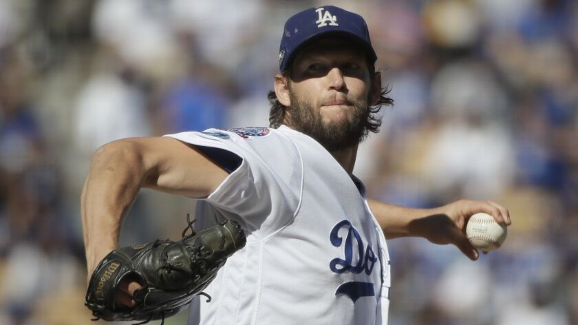 FILE - In this Oct. 17, 2018, file photo, Los Angeles Dodgers starting pitcher Clayton Kershaw throw
