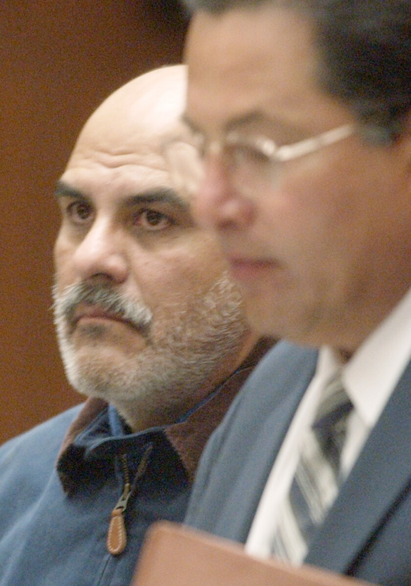 In this file photo, John Anthony Salazar, a former priest accused of sexually assaulting two boys in Los Angeles in the 1980s, appears with his attorney, Daniel Guerrero, right, in Superior Court in Los Angeles for his arraignment in 2003.