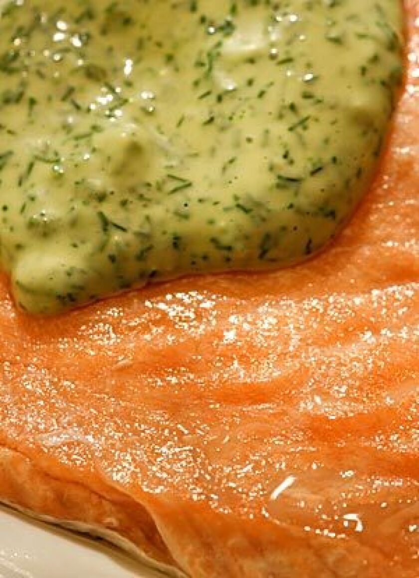 Oven-steamed salmon with dill sauce.